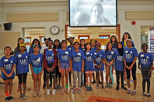Middle school girls pose for a photo with a scientist (who joined them via Skype) at a geoscience camp for girls organized by doctoral students in the School of Earth, Society, and Environment. (Photo courtesy of Aida Guhlincozzi and Julia Cisneros.)